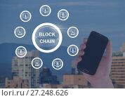 Купить «Block chain network circles and hand holding phone», фото № 27248626, снято 11 декабря 2017 г. (c) Wavebreak Media / Фотобанк Лори