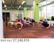Купить «group of people doing push-ups in gym», фото № 27248818, снято 19 февраля 2017 г. (c) Syda Productions / Фотобанк Лори