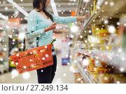 Купить «customer with basket at grocery or supermarket», фото № 27249134, снято 2 ноября 2016 г. (c) Syda Productions / Фотобанк Лори