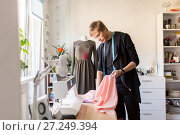 Купить «fashion designer with cloth making dress at studio», фото № 27249394, снято 28 июня 2017 г. (c) Syda Productions / Фотобанк Лори
