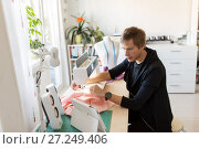 Купить «fashion designer with tablet pc sewing at studio», фото № 27249406, снято 28 июня 2017 г. (c) Syda Productions / Фотобанк Лори
