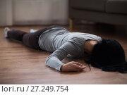 Купить «dead woman body lying on floor at crime scene», фото № 27249754, снято 5 мая 2017 г. (c) Syda Productions / Фотобанк Лори