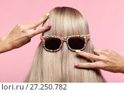 Купить «Rear view of young woman. Blond stright hair with fun sunglasses», фото № 27250782, снято 9 сентября 2017 г. (c) Serg Zastavkin / Фотобанк Лори