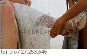 Купить «Happy bride and bridesmaid helping her to wear sandals 4K 4k», видеоролик № 27253646, снято 15 октября 2019 г. (c) Wavebreak Media / Фотобанк Лори
