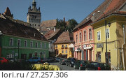 Купить «Medieval streets of Sighisoara with famous clock tower, Transylvania, Romania», видеоролик № 27257306, снято 16 сентября 2017 г. (c) Яков Филимонов / Фотобанк Лори