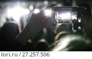 Купить «Spectators at the music concert shooting video on the smartphone», видеоролик № 27257506, снято 27 марта 2019 г. (c) Константин Шишкин / Фотобанк Лори