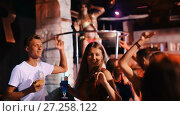 Купить «Group of smiling people clubbing in the night club with drinks», видеоролик № 27258122, снято 7 сентября 2017 г. (c) Яков Филимонов / Фотобанк Лори