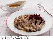 Купить «Boiled meat with buckwheat porridge», фото № 27258178, снято 26 ноября 2017 г. (c) Stockphoto / Фотобанк Лори