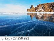 Купить «Озеро Байкал зимой. Природная достопримечательность - мыс Хобой в закатном свете отражается в зеркальной глади синего льда», фото № 27258922, снято 8 марта 2012 г. (c) Виктория Катьянова / Фотобанк Лори