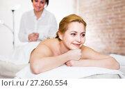Купить «Young woman is happy with procedure massage in beauty parlor», фото № 27260554, снято 7 марта 2017 г. (c) Яков Филимонов / Фотобанк Лори
