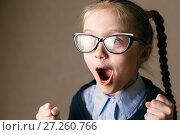 Купить «Schoolgirl in a shock. Educational concept», фото № 27260766, снято 23 ноября 2017 г. (c) Иван Карпов / Фотобанк Лори