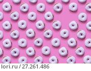 Купить «Коллаж и фон из пончиков покрытых сладкой глазурью на розовом фоне», фото № 27261486, снято 26 июня 2019 г. (c) V.Ivantsov / Фотобанк Лори