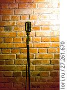Купить «A microphone ready on stage against a brick wall ready for the Karaoke performer», фото № 27261670, снято 7 июня 2020 г. (c) Евгений Ткачёв / Фотобанк Лори