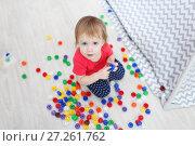 Купить «Cute 1 years blue-eyed baby girl plays multicolored meccano at home», фото № 27261762, снято 27 октября 2017 г. (c) ivolodina / Фотобанк Лори