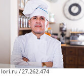 Купить «happy bakery male worker with delicious pies and rolls on counter», фото № 27262474, снято 22 апреля 2017 г. (c) Яков Филимонов / Фотобанк Лори