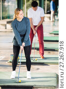 Купить «Man 30-35 years old are woman 25-29 years old golf players are enjoying game», фото № 27267918, снято 18 декабря 2018 г. (c) Яков Филимонов / Фотобанк Лори