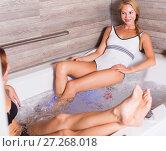 Купить «Young women are talking while enjoying aromatherapy», фото № 27268018, снято 18 июля 2017 г. (c) Яков Филимонов / Фотобанк Лори