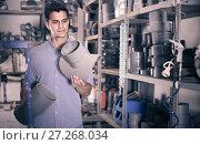 Купить «Man 35-40 years old is choosing plastic trumpet in plumbing department», фото № 27268034, снято 26 июля 2017 г. (c) Яков Филимонов / Фотобанк Лори