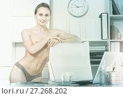 Купить «Portrait of young girl in underpants in the office», фото № 27268202, снято 24 апреля 2017 г. (c) Яков Филимонов / Фотобанк Лори