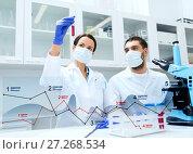 Купить «scientists with test tubes making research at lab», фото № 27268534, снято 4 декабря 2014 г. (c) Syda Productions / Фотобанк Лори