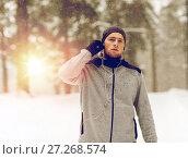 Купить «sports man with earphones in winter forest», фото № 27268574, снято 10 ноября 2016 г. (c) Syda Productions / Фотобанк Лори
