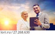 Купить «smiling businessmen with tablet pc outdoors», фото № 27268630, снято 19 августа 2014 г. (c) Syda Productions / Фотобанк Лори