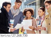 Купить «international business team with papers outdoors», фото № 27268730, снято 13 мая 2017 г. (c) Syda Productions / Фотобанк Лори