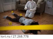 Купить «criminalist collecting evidence at crime scene», фото № 27268778, снято 5 мая 2017 г. (c) Syda Productions / Фотобанк Лори