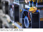 Купить «cryptocurrency equipment mining», фото № 27269322, снято 11 ноября 2017 г. (c) Mark Agnor / Фотобанк Лори