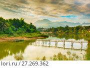 Beautiful view of a bamboo bridge. Laos landscape. (2017 год). Редакционное фото, фотограф Ольга Хорошунова / Фотобанк Лори