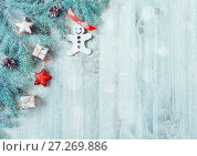 Купить «Christmas background. Christmas toys, blue fir tree branches on the wooden background. Christmas still life», фото № 27269886, снято 8 мая 2017 г. (c) Зезелина Марина / Фотобанк Лори