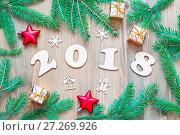 Купить «New Year 2018 background with 2018 figures, Christmas decorations and fir branches. New Year 2018 still life», фото № 27269926, снято 29 ноября 2016 г. (c) Зезелина Марина / Фотобанк Лори