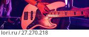 Купить «Female guitarist playing guitar with drummer in nightclub», фото № 27270218, снято 12 декабря 2017 г. (c) Wavebreak Media / Фотобанк Лори