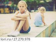Купить «Small sisters upset after quarrel outside», фото № 27270978, снято 20 июля 2017 г. (c) Яков Филимонов / Фотобанк Лори