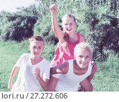 Купить «Girl with two friends running on park», фото № 27272606, снято 27 июля 2017 г. (c) Яков Филимонов / Фотобанк Лори