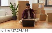 Купить «man with laptop shopping online at new home», видеоролик № 27274114, снято 30 ноября 2017 г. (c) Syda Productions / Фотобанк Лори