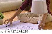 Купить «man with boxes and blueprint moving to new home», видеоролик № 27274210, снято 30 ноября 2017 г. (c) Syda Productions / Фотобанк Лори