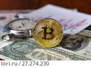 Купить «Монета биткоин, графики, секундомер и доллары», эксклюзивное фото № 27274230, снято 8 декабря 2017 г. (c) Юрий Морозов / Фотобанк Лори