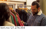 couple choosing clothes at vintage clothing store. Стоковое видео, видеограф Syda Productions / Фотобанк Лори