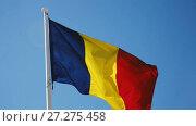 Купить «Romanian flag is national symbol of country.», видеоролик № 27275458, снято 6 октября 2017 г. (c) Яков Филимонов / Фотобанк Лори