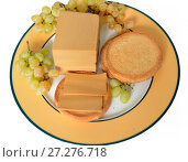 Купить «Famous Brunost (brown cheese) is common, Norwegian name for mysost, family of cheese-related foods made with whey, milk and/or cream. Brunost is primarily produced and consumed in Norway», фото № 27276718, снято 17 сентября 2016 г. (c) Валерия Попова / Фотобанк Лори