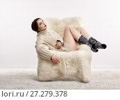 Купить «Brunette woman on furry arm-chair», фото № 27279378, снято 8 октября 2017 г. (c) Serg Zastavkin / Фотобанк Лори