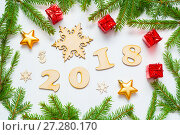 Купить «New Year 2018 background with 2018 figures,Christmas toys, fir branches - New Year 2018 composition», фото № 27280170, снято 30 ноября 2016 г. (c) Зезелина Марина / Фотобанк Лори