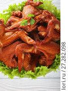 Купить «close-up of crispy smoked chicken wings», фото № 27282098, снято 1 декабря 2017 г. (c) Oksana Zh / Фотобанк Лори