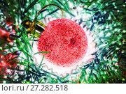 Red Christmas ball with sparkles. Christmas tinsel. Стоковое фото, фотограф Евгений Ткачёв / Фотобанк Лори