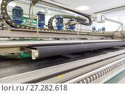 Купить «Automatic washing and cleaning of carpets. Industrial line for washing carpets», фото № 27282618, снято 19 июня 2017 г. (c) Евгений Ткачёв / Фотобанк Лори