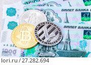 Купить «Cryptocurrency coins lying on the russian ruble banknotes. Business concept of new virtual money», фото № 27282694, снято 11 декабря 2017 г. (c) FotograFF / Фотобанк Лори