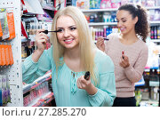 Купить «Female customers choosing mascara», фото № 27285270, снято 22 апреля 2018 г. (c) Яков Филимонов / Фотобанк Лори