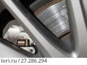 Купить «Car wheel fragment with brake disc, closeup», фото № 27286294, снято 23 сентября 2017 г. (c) EugeneSergeev / Фотобанк Лори