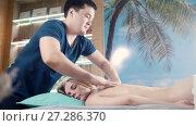 Купить «Young woman lying on massage table at spa salon», видеоролик № 27286370, снято 18 июля 2019 г. (c) Константин Шишкин / Фотобанк Лори